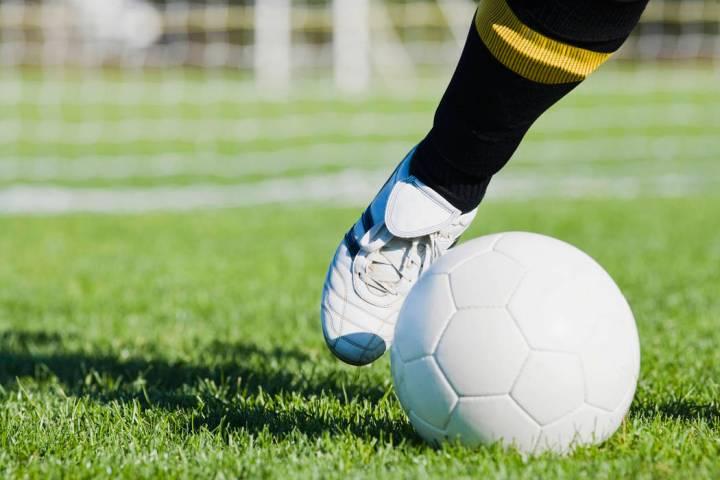 A soccer player kicking a soccer ball (Thinkstock)