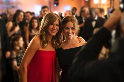 This image released by Apple TV Plus, Jennifer Aniston, left, and Reese Witherspoon appear in a ...