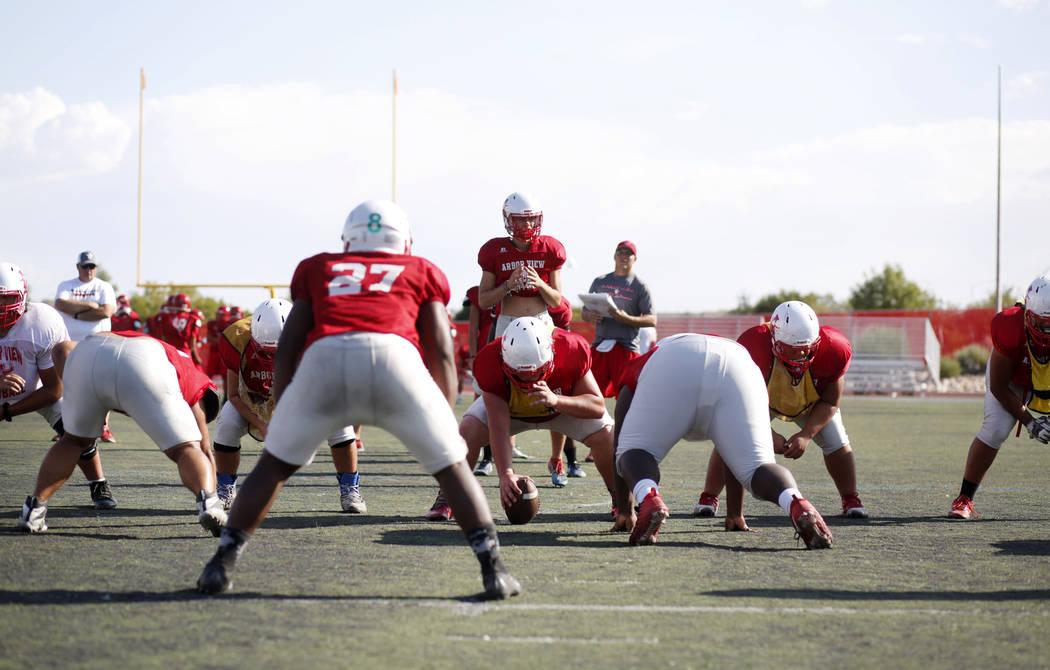 Arbor View's varsity football team runs drills during practice at Arbor View High School in Las ...