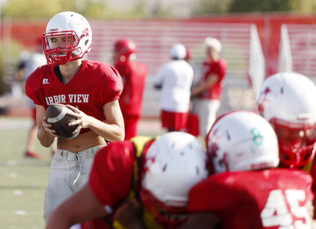 Arbor View's varsity quarterback Kyle Holmes (17), runs drills during practice at Arbor View Hi ...