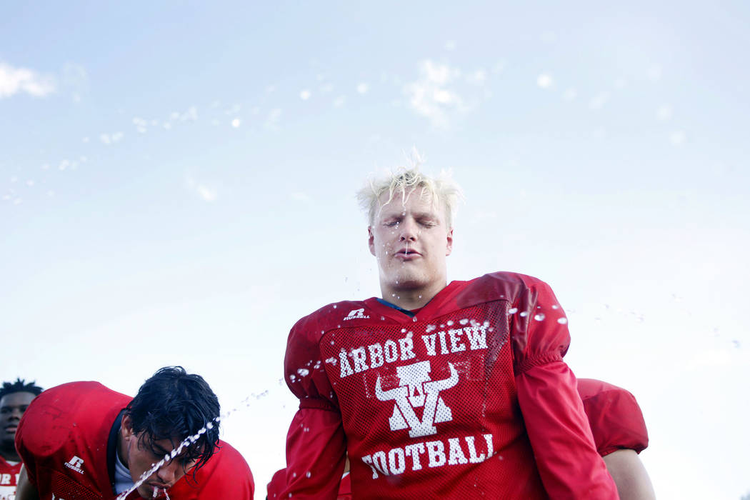 Arbor View's running back Justin Hausner (31), cools off during practice at Arbor View High Sch ...
