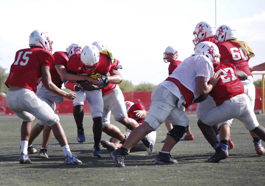 Arbor View's varsity defensive back D'Andre Washington (13), clutches the ball during practice ...
