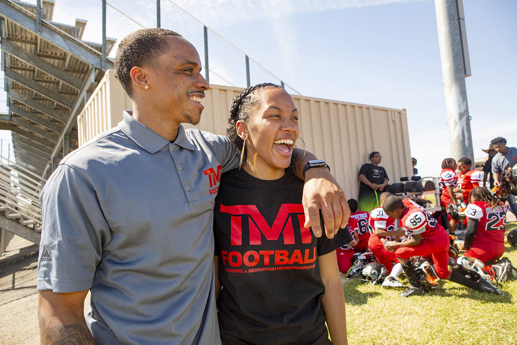 Devin Conway laughs with his wife Alvina Coway during halftime of the youth football TMT Red Li ...