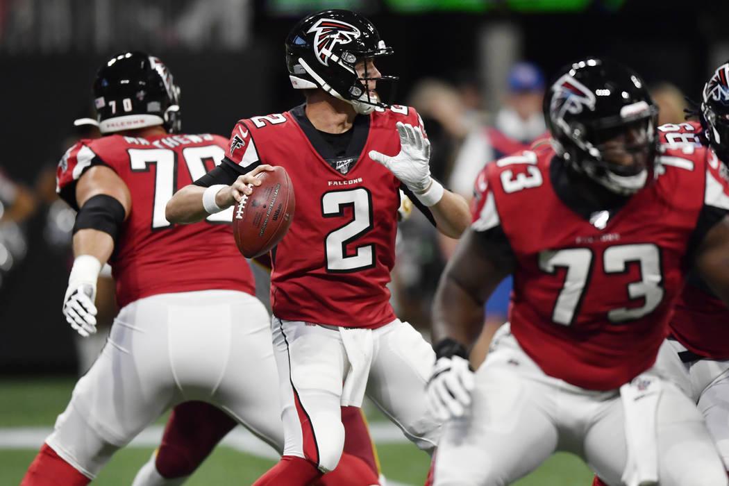 Atlanta Falcons quarterback Matt Ryan (2) works in the pocket against the Washington Redskins d ...