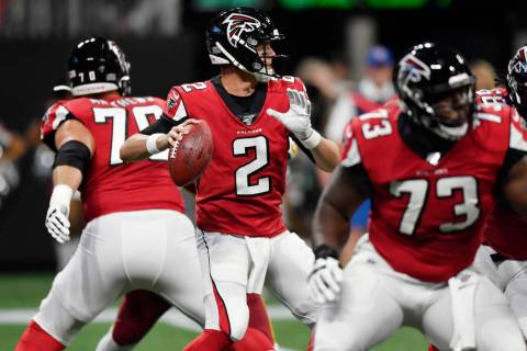 Atlanta Falcons quarterback Matt Ryan (2) works in the pocket against the Washington Redskins d ...