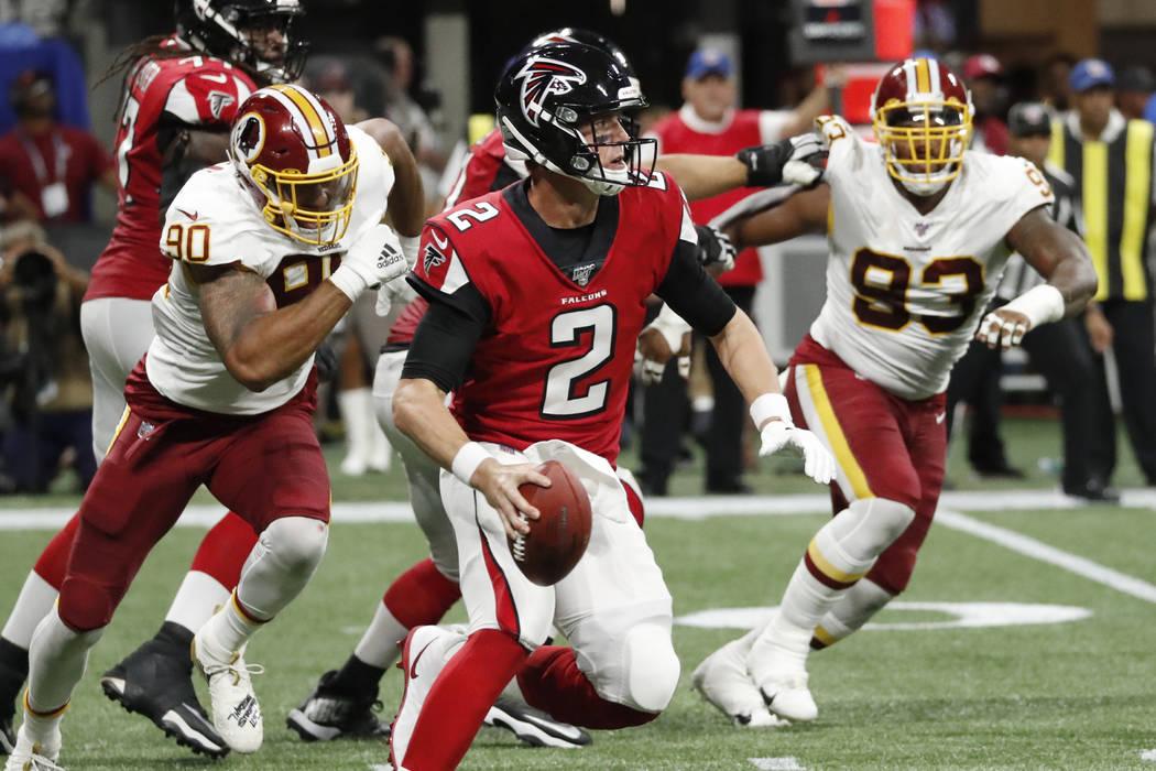 Atlanta Falcons quarterback Matt Ryan (2) runs out of the pocket against the Washington Redskin ...