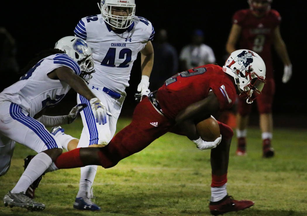 Liberty High's Germie Bernard (2) scrambles away from Chandler, Ariz., High's defense, includin ...