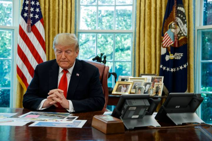 President Donald Trump listens during a briefing on Hurricane Dorian in the Oval Office of the ...