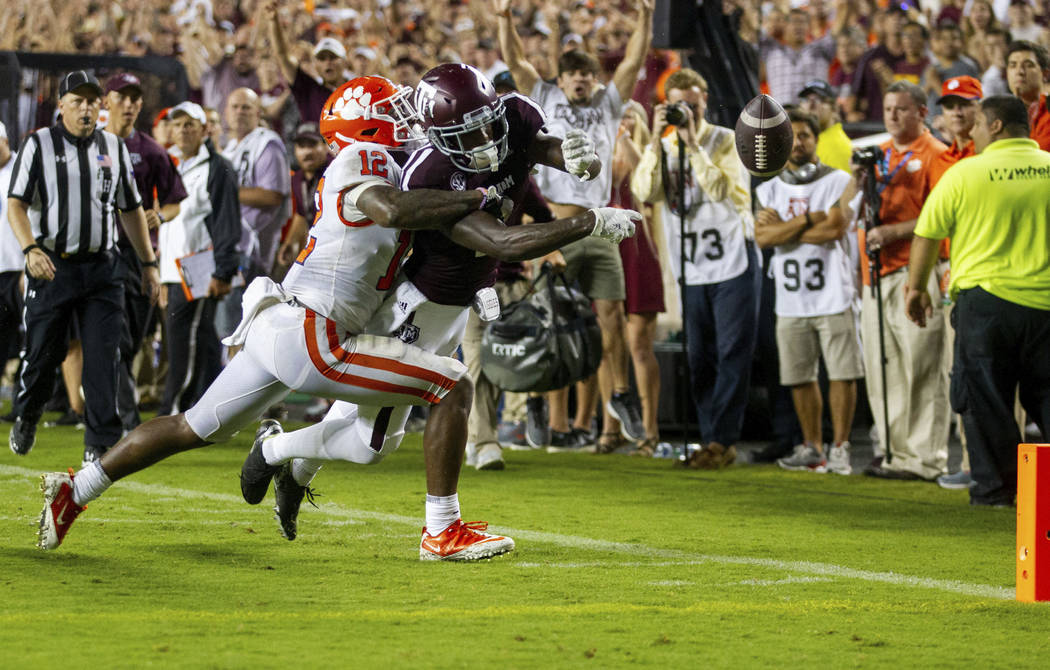 Texas A&M wide receiver Quartney Davis (1) has the ball punched out of his hands for a touc ...