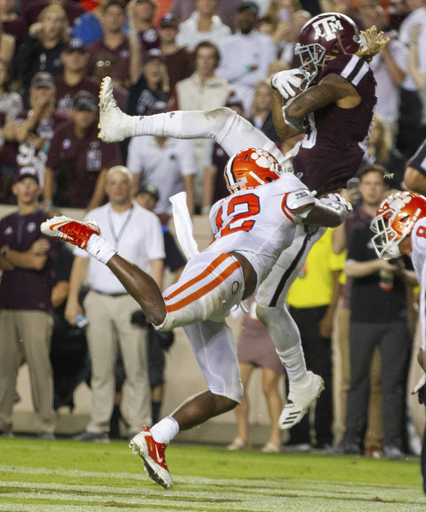 Texas A&M wide receiver Kendrick Rogers, top,catch a pass for a touchdown as Clemson defens ...