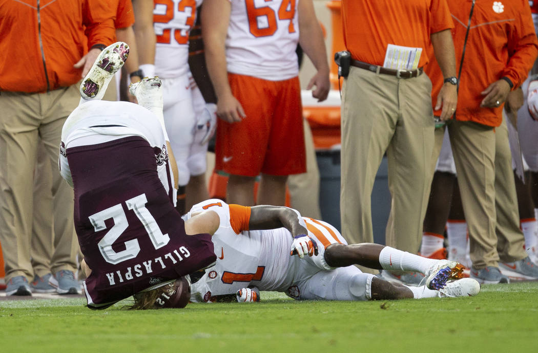 Texas A&M fullback Cullen Gillaspia (12) is flipped over by Clemson cornerback Trayvon Mull ...
