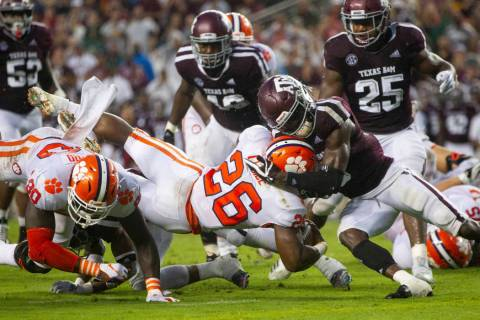 Texas A&M defensive back Donovan Wilson (6) stops Clemson running back Adam Choice (26) sho ...