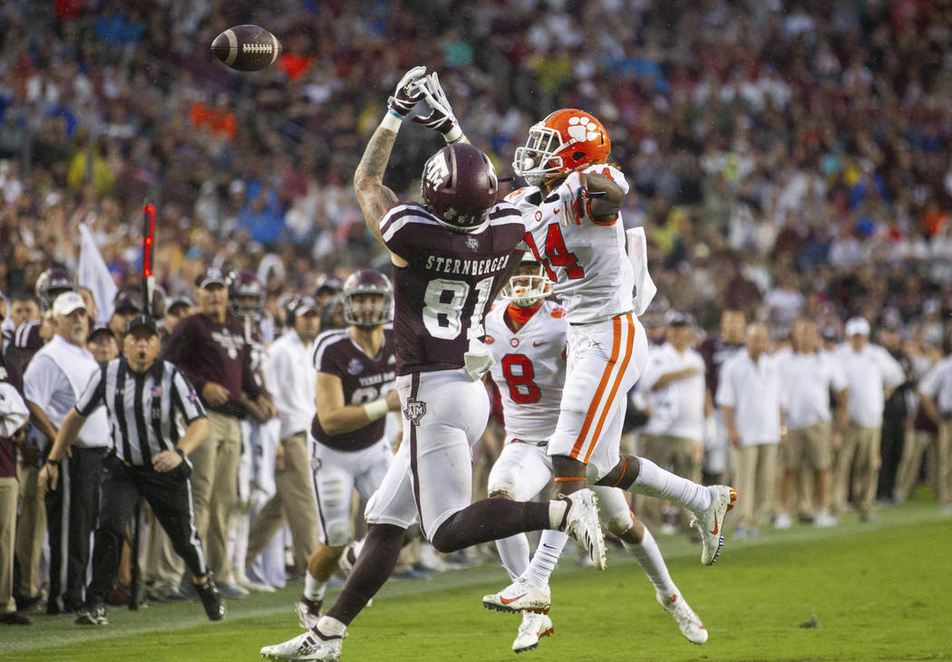 Clemson safety Denzel Johnson (14) knocks away a pass intended for Texas A&M tight end Jace ...