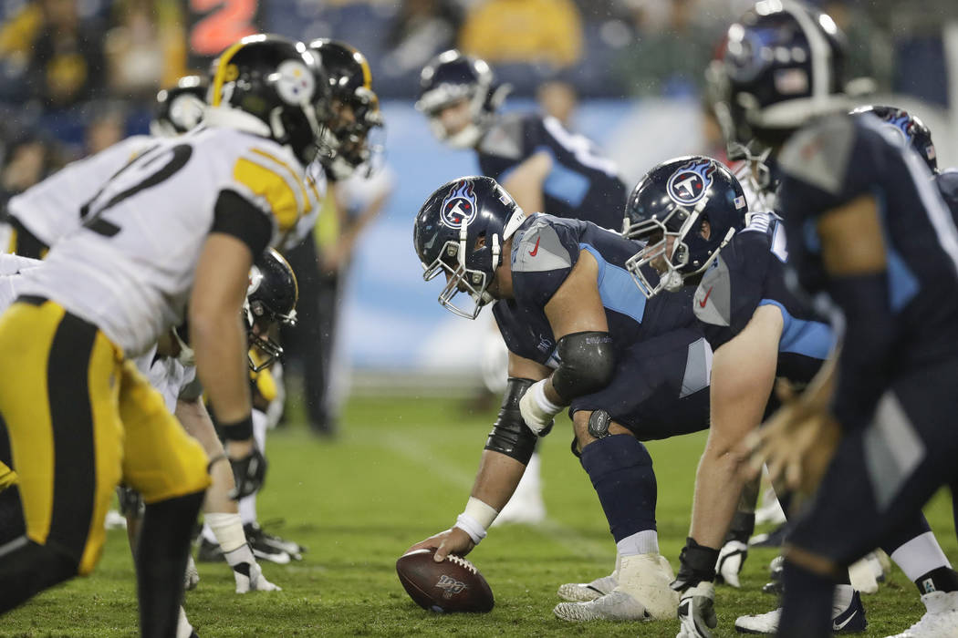 Tennessee Titans center Hroniss Grasu gets set to snap the ball against the Pittsburgh Steelers ...