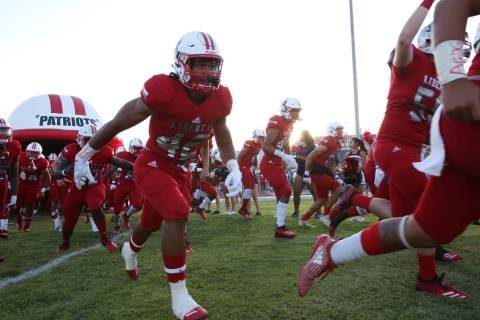 The Liberty High school football players take the field against Chandler, Ariz., in 2018 in Hen ...