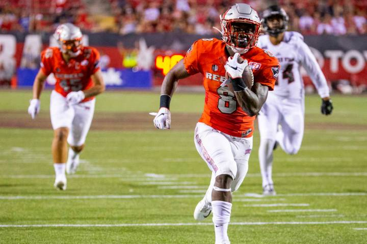 UNLV Rebels running back Charles Williams (8) runs for a touchdown over Southern Utah during th ...