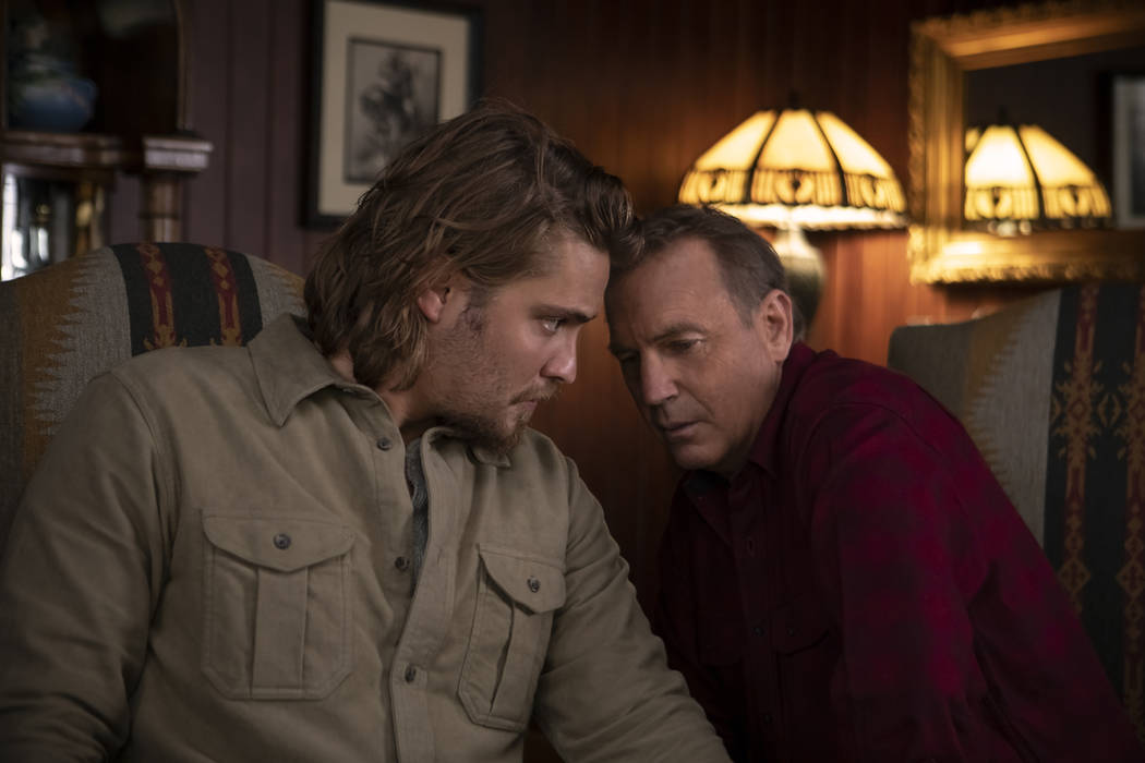 Kayce (L-Luke Grimes) talks with his father (R-Kevin Costner) and decides to track down evidenc ...