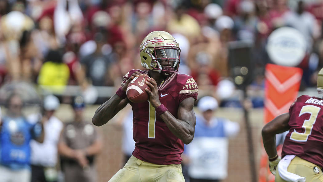 Florida State quarterback James Blackman (1) looks for a receiver during an NCAA football game ...