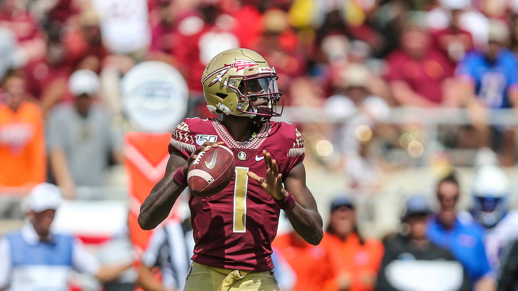 Florida State quarterback James Blackman (1) looks for a receiver during the second half of an ...