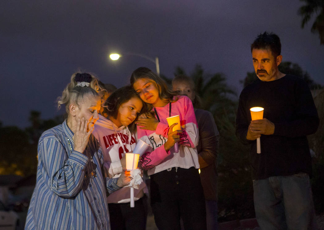 Mary Ann Ratay, left, talks about her daughter, Jennifer Ratay, during a vigil in her memory wh ...