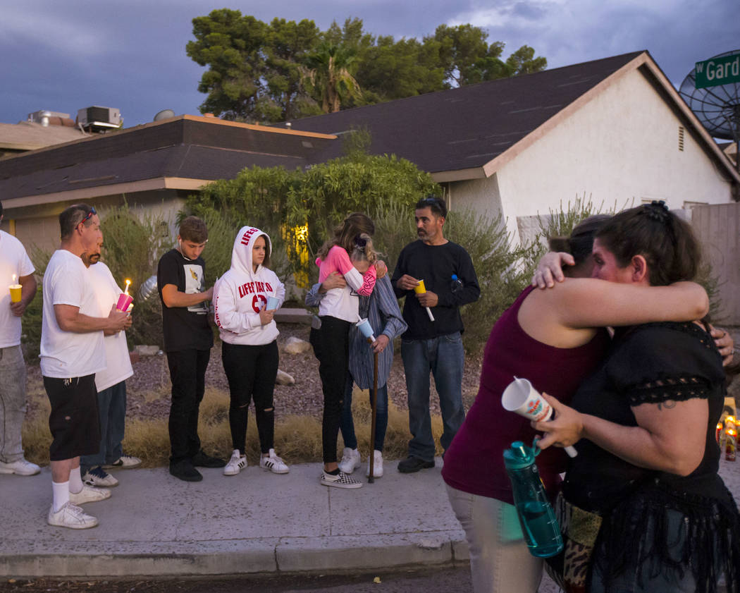 Kelsi Jackson, 15, center, hugs her grandmother, Mary Ann Ratay, during a vigil in memory of Je ...