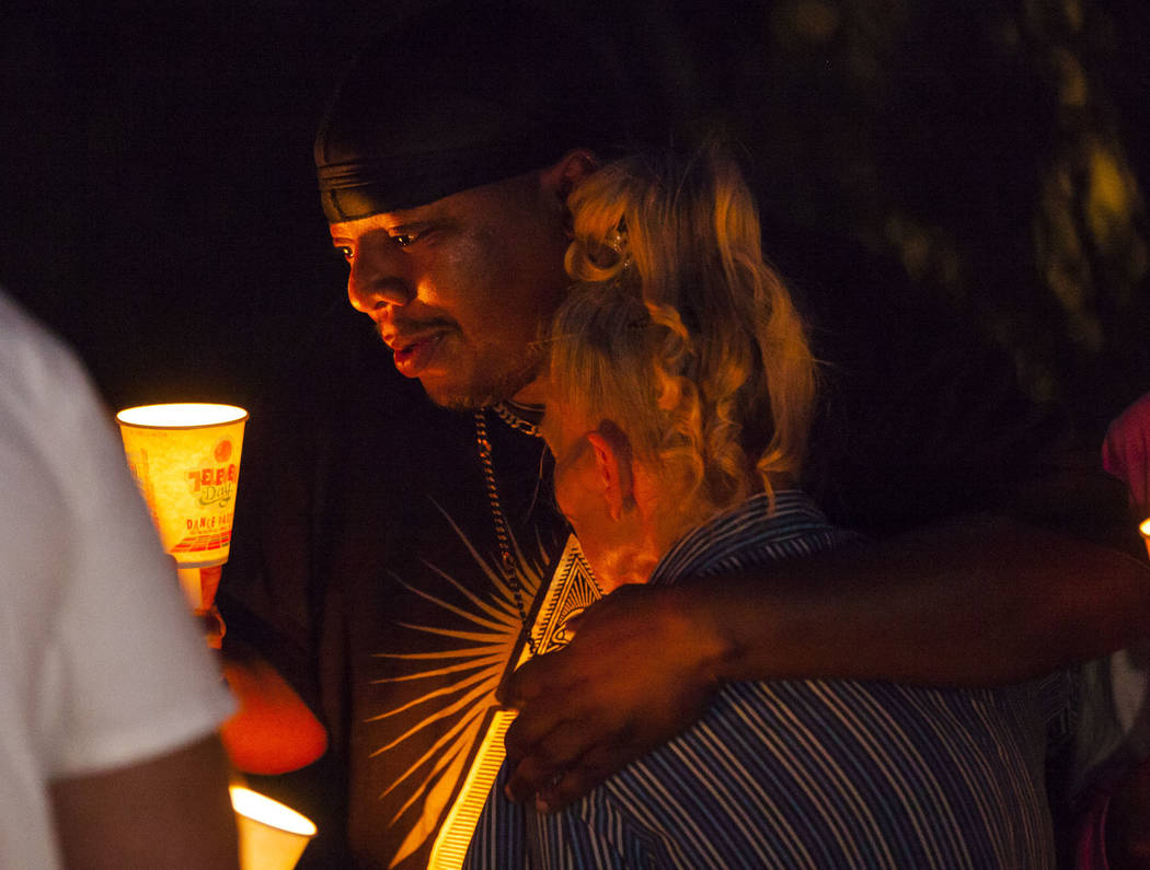 Mario Smith comforts Mary Ann Ratay during a vigil in memory of Jennifer Ratay, daughter of Mar ...