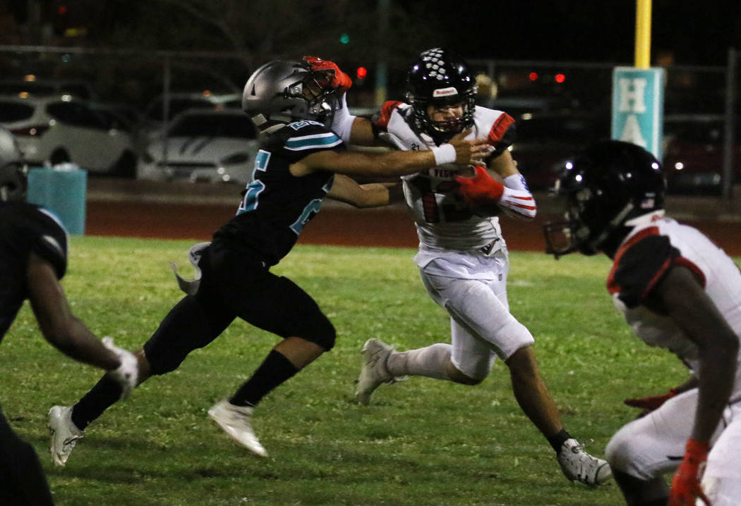 Las Vegas High's wide receiver Dalten Silet (13) avoids a tackle from Silverado High's Jeremy A ...