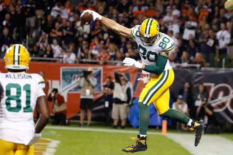 Green Bay Packers' Jimmy Graham reacts after catching a touchdown pass during the first half of ...