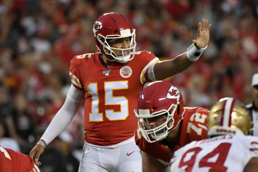 Kansas City Chiefs quarterback Patrick Mahomes (15) gestures during the first half of an NFL pr ...