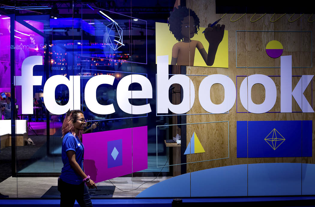 In a Tuesday, April 18, 2017, file photo, a conference worker passes a demo booth at Facebook's ...