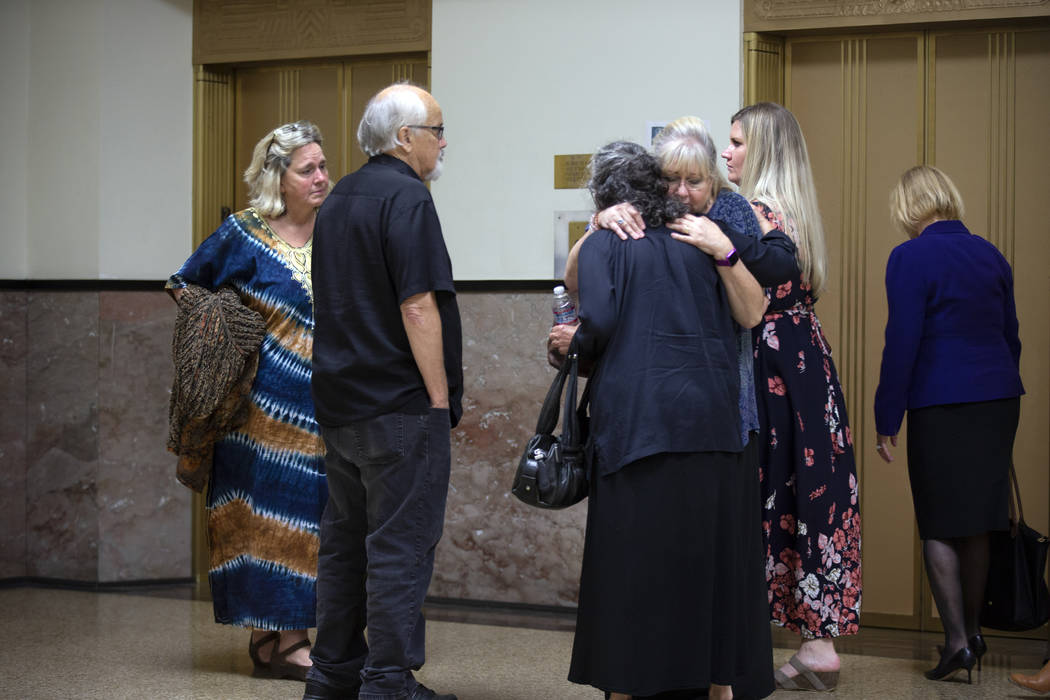 Family members of the victims hug each other after learning of the not guilty verdicts in the G ...