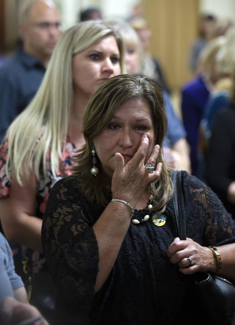 Esperanza Gonzalez, aunt of fire victim Alex Vega, wipes away tears as she listens to comments ...