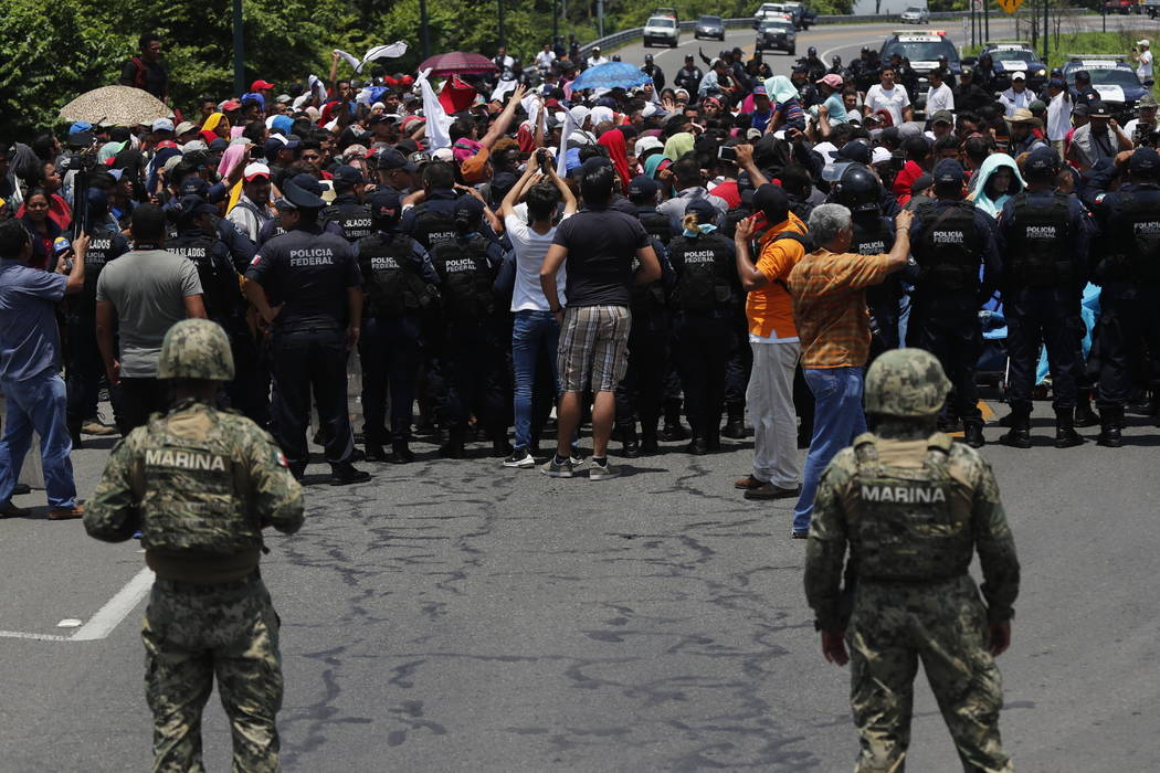 In a June 5, 2019, file photo, Mexican authorities stop a migrant caravan that had earlier cros ...