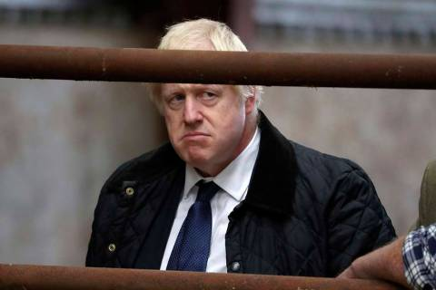 Britain's Prime Minister Boris Johnson visits Darnford Farm in Banchory near Aberdeen, Scotland ...