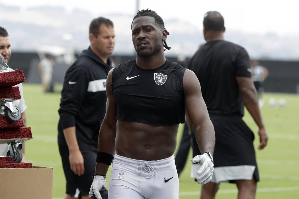 Oakland Raiders' Antonio Brown walks off the field after NFL football practice in Alameda, Cali ...