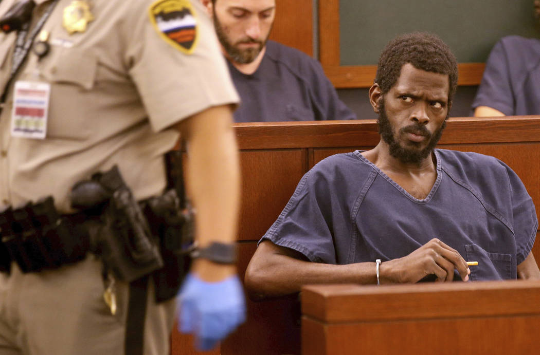 Clinton Taylor, front, appears in court at the Regional Justice Center in Las Vegas Wednesday, ...