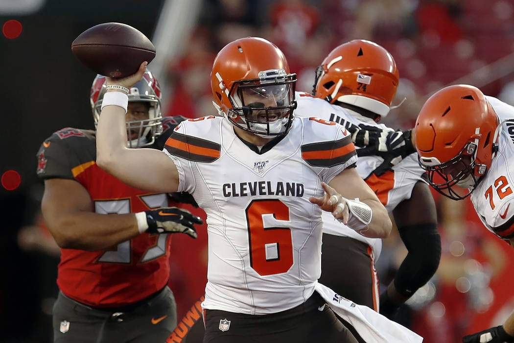 In this Friday, Aug. 23, 2019, file photo, Cleveland Browns quarterback Baker Mayfield (6) thro ...