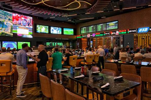 The Borgata's 8,000-square-foot Moneyline Bar and Book features a 35-foot-long circular bar wit ...