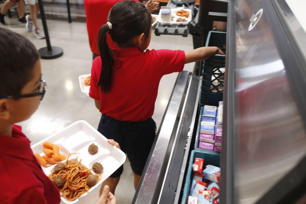 Legacy Traditional School students have lunch during the opening week of the southwest Las Vega ...