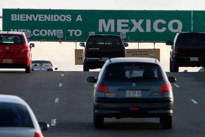 Southbound vehicles leave El Paso, Texas and enter Juarez, Mexico at the Bridge of the Americas ...