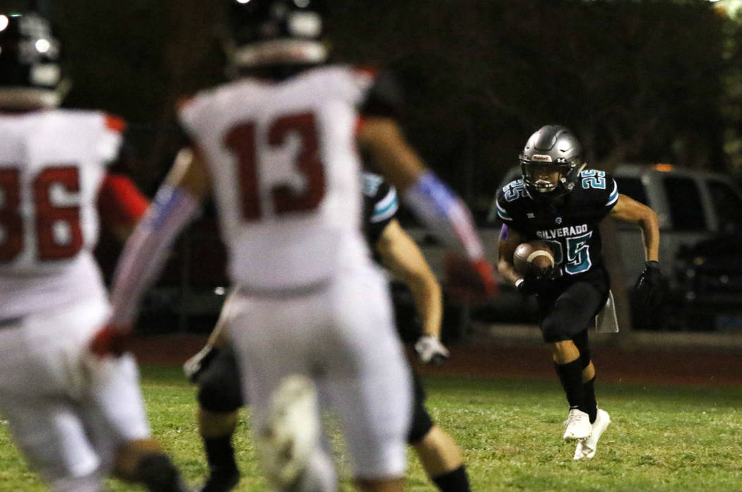 Silverado High's Jeremy Alipio (25) returns punt during the first half of their football game a ...