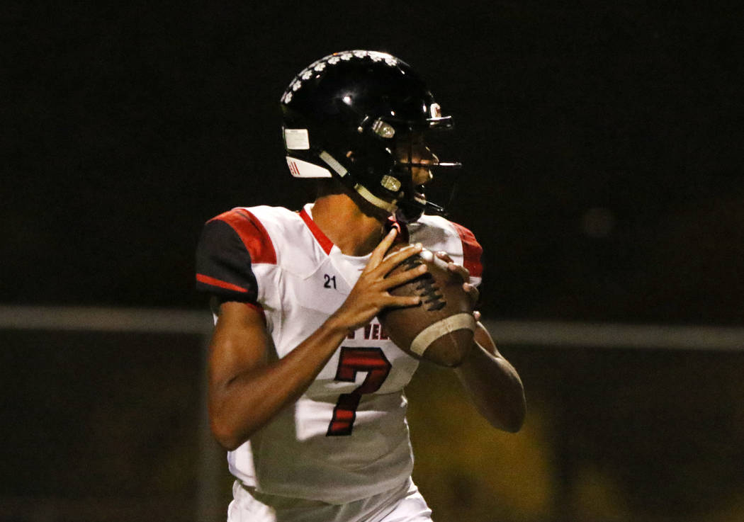 Las Vegas High's quarterback Ja'shawn Scroggins sets up to pass the ball during the first half ...