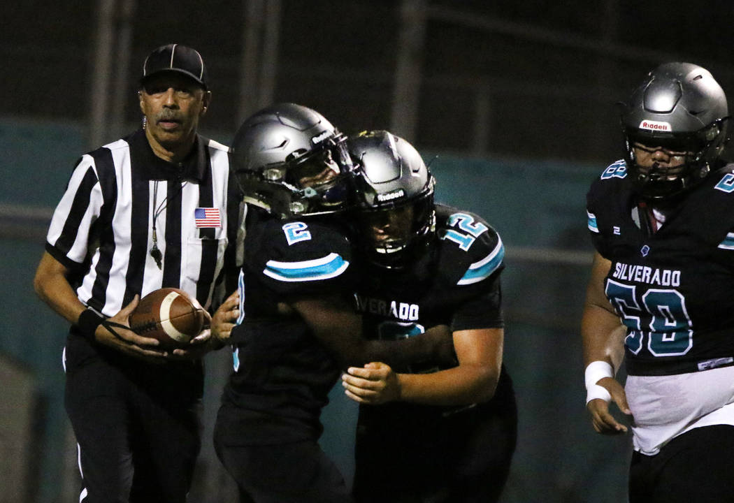 Silverado High's running back Aginae Cunningham (2) celebrates his touchdown with his teammate ...