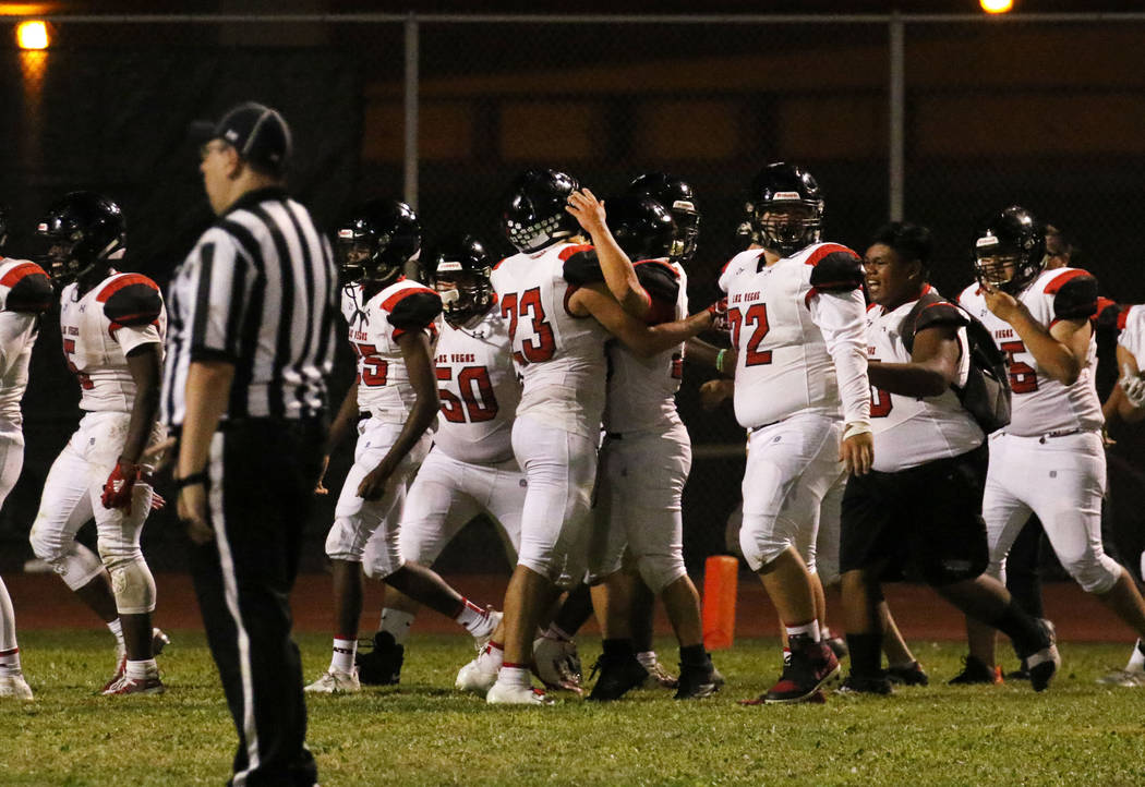 Las Vegas High players celebrate their 39-28 win against Silverado High during the second half ...