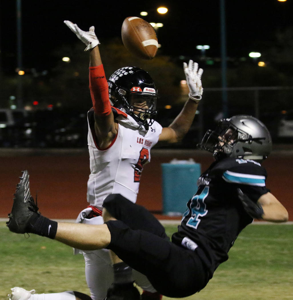 Silverado High's wide receiver Ryan Thomas (14) catches for a touchdown as Las Vegas High's wid ...