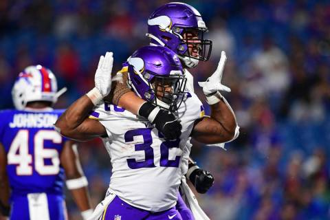 Minnesota Vikings running back De'Angelo Henderson (32) celebrates his touchdown with offensive ...