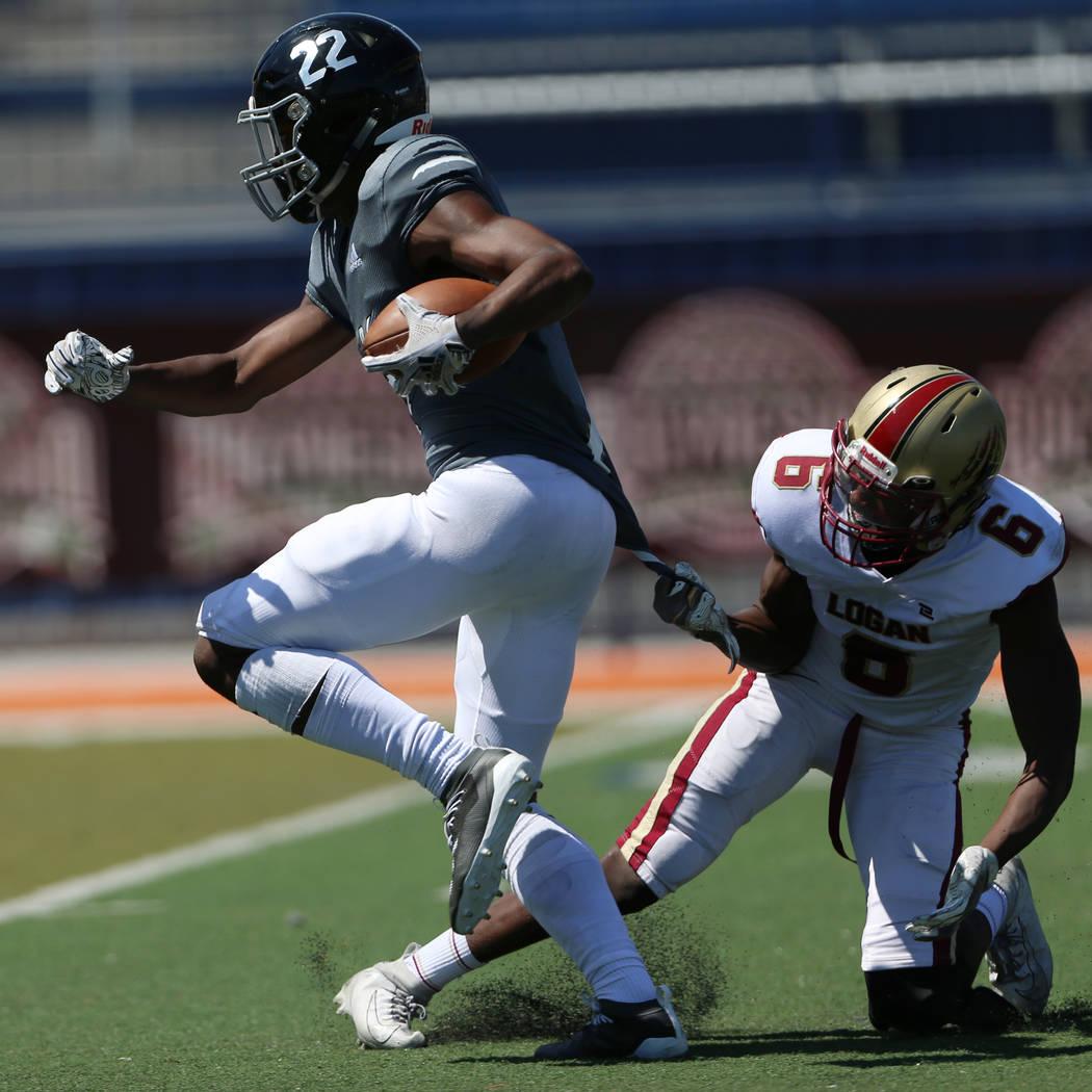 Desert Pines' Javontae Barnes (22) runs the ball for a touchdown against Logan's Isaac Larsen ( ...