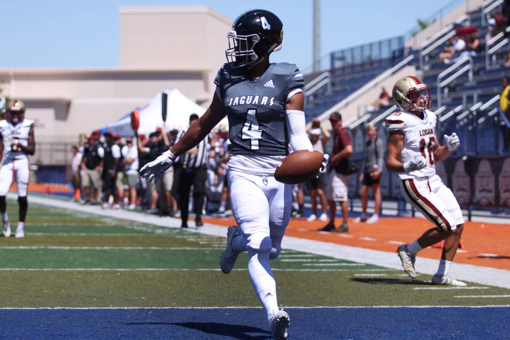 Desert Pines' Branden Thomas (4) scores a touchdown against Logan during the first quarter of t ...