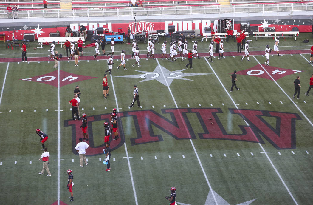 UNLV football players warm up before taking on Arkansas State in an NCAA football game at Sam B ...