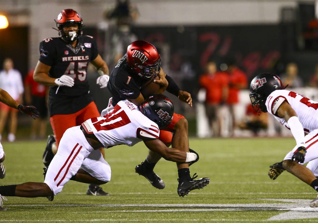 Arkansas State Red Wolves defensive back Detravion Green (20) tackles UNLV Rebels quarterback A ...